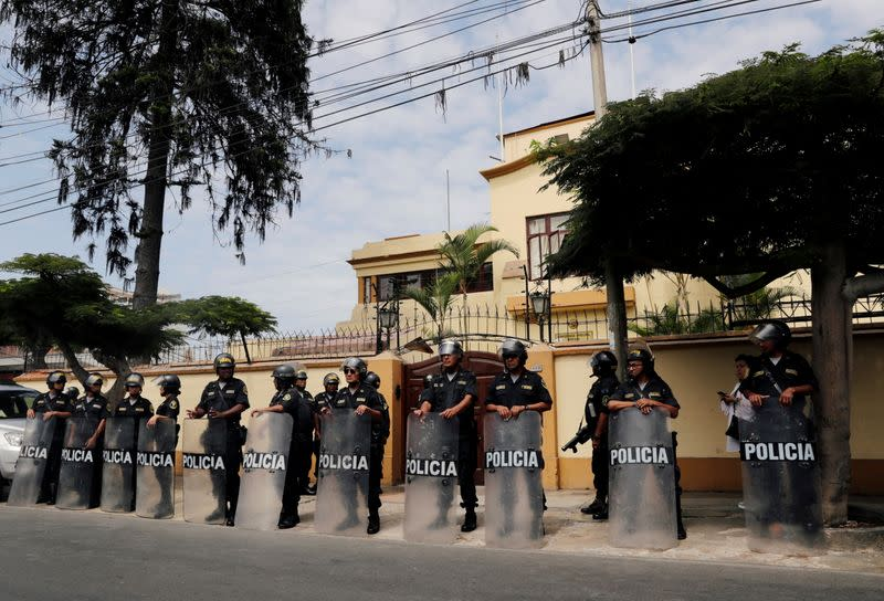 FILE PHOTO: Police officers stand guard outside at the Episcopal Conference of Peru
