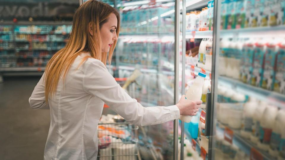 Young woman shopping in the supermarket.