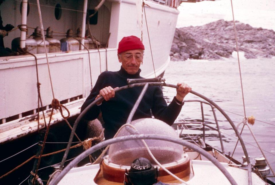 <p>Jacques-Yves Cousteau aboard a submarine with the RV Calypso off to the side in 1970.</p>