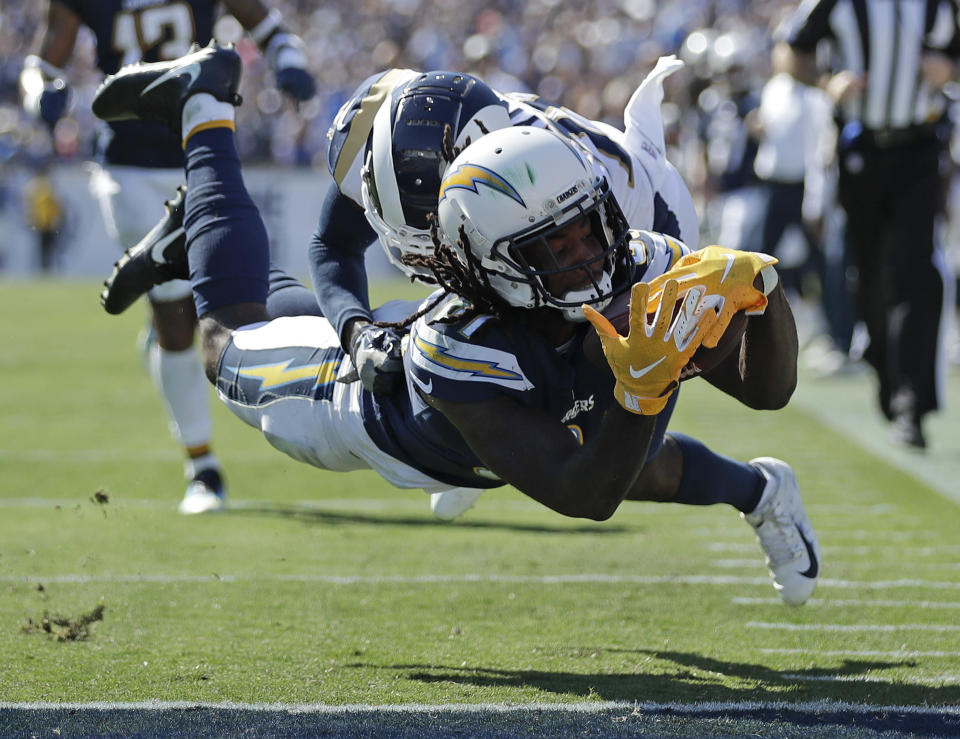 <p>Los Angeles Chargers wide receiver Mike Williams scores in front of Los Angeles Rams defensive back Lamarcus Joyner during the second half in an NFL football game Sunday, Sept. 23, 2018, in Los Angeles. (AP Photo/Jae C. Hong) </p>