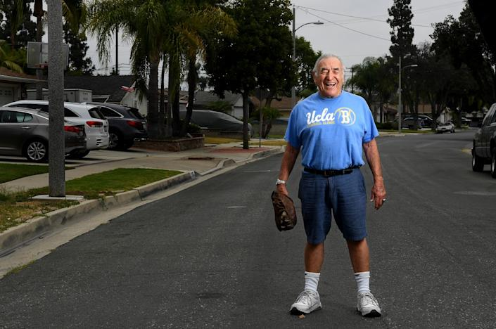 "Ernie Rodriguez in his Whittier neighborhood with the first baseball glove he owned. Rodriguez was an outfielder who debuted with the Chorizeros when he was 16. <span class=""copyright"">(Wally Skalij / Los Angeles Times)</span>"