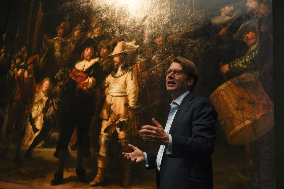 The added part of the painting is seen right as Rijksmuseum director Taco Dibbits explains how Rembrandt's biggest painting the Night Watch just got bigger with the help of artificial intelligence in Amsterdam, Netherlands, Wednesday, June 23, 2021. The Dutch national museum and art gallery reveals findings from a long-term project to examine in minute detail Rembrandt van Rijn's masterpiece the Night Watch. (AP Photo/Peter Dejong)