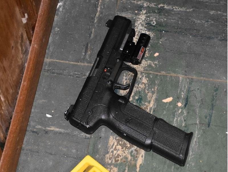 One of two loaded FN Five-Seven 5.7 mm pistols pistols with extended 30 round magazines were located in the basement.