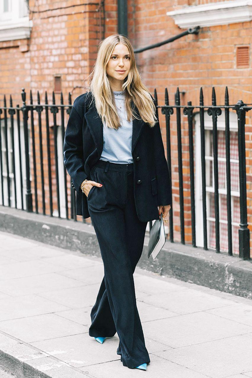 Navy trousers keep a black blazer from looking like it was meant for a corporate boardroom.