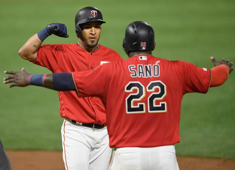 Miguel Sano of the Minnesota Twins congratulates teammate Eddie Rosario