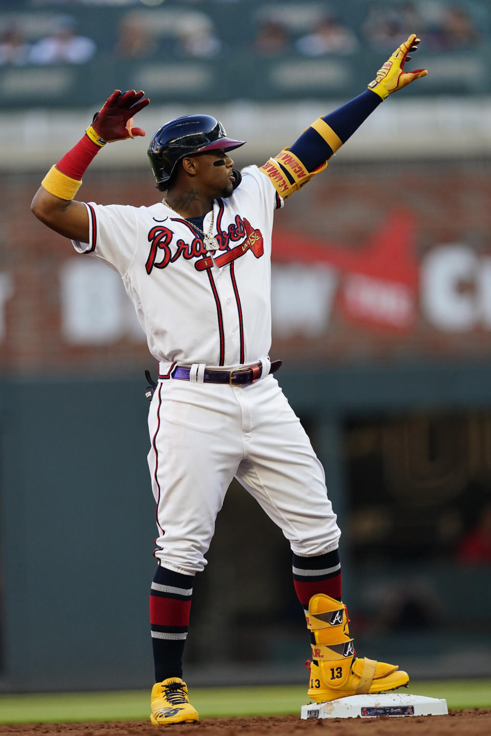 Atlanta Braves right fielder Ronald Acuna Jr., strikes a pose as he stands on second base after hitting a double in the first inning of a baseball game against the Boston Red Sox Wednesday, June 16, 2021, in Atlanta. (AP Photo/John Bazemore)