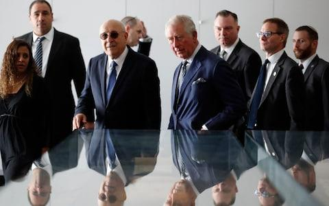 The Prince of Wales (centre) and the Chairman of the Board of Directors of the Israel Museum Isaac Molho (third left) at a reception for British Holocaust survivors at the Israel Museum in Jerusalem - Credit: Frank Augstein