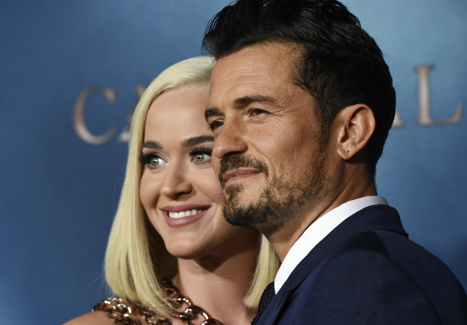 """Orlando Bloom, right, a cast member in the Amazon Prime Video series """"Carnival Row,"""" poses with his girlfriend, singer Katy Perry, at the premiere of the series at the TCL Chinese Theatre, Wednesday, Aug. 21, 2019, in Los Angeles. (Photo by Chris Pizzello/Invision/AP)"""