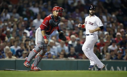 Boston Red Sox's Mitch Moreland, right, is forced out at home plate as Los Angeles Angels' Jose Briceno watches his throw to first to complete a double play on Rafael Devers during the sixth inning of a baseball game in Boston, Thursday, June 28, 2018. (AP Photo/Michael Dwyer)