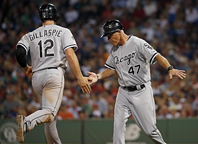 Chicago White Sox's Conor Gillaspie is congratulated by third base coach Joe McEwing (47) after hitting a two-run homer in the sixth inning of a baseball game against the Boston Red Sox at Fenway Park in Boston, Tuesday, July 8, 2014. (AP Photo/Elise Amendola)