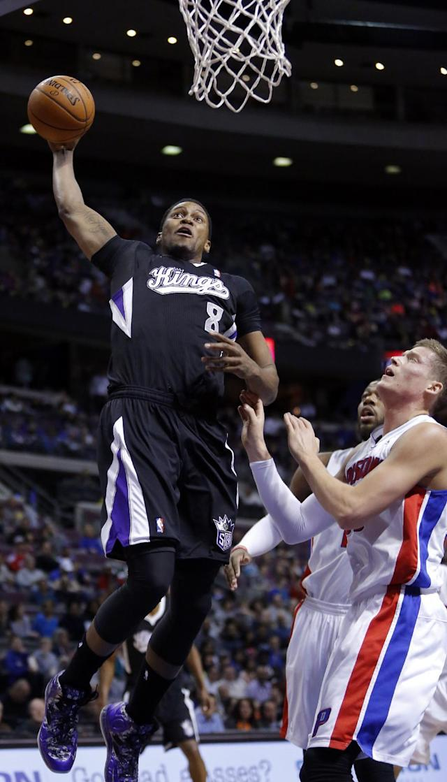 Sacramento Kings forward Rudy Gay (8) goes up to dunk over Detroit Pistons forward Jonas Jerebko, right, during the first half of an NBA basketball game, Tuesday, March 11, 2014, in Auburn Hills, Mich. (AP Photo/Duane Burleson)