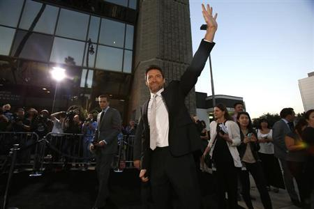 "Cast member Hugh Jackman waves at fans at the premiere of his film ""Prisoners"" at the Academy of Motion Picture Arts and Sciences in Beverly Hills, California September 12, 2013. REUTERS/Mario Anzuoni"