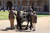 <p>A horse and carriage does a lap of the quadrangle, in tribute to Prince Philip's love of carriage driving. </p>