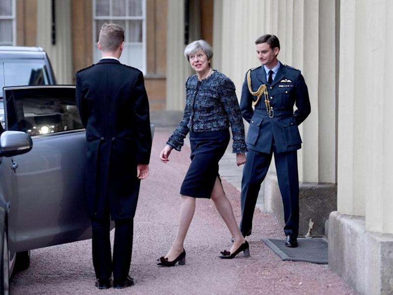 Theresa May leaves Buckingham Palace after meeting Queen Elizabeth after Parliament was dissolved ahead of the general election: Reuters