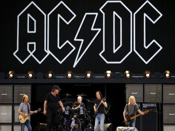 Members of the rock group AC/DC (L-R) Stevie Young, Brian Johnson, Chris Slade, Angus Young and Cliff Williams.