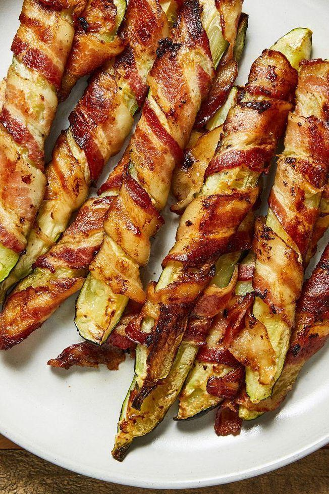 """<p>Anything wrapped in <a href=""""https://www.delish.com/uk/cooking/recipes/a30208165/how-to-cook-bacon-in-the-oven-recipe/"""" rel=""""nofollow noopener"""" target=""""_blank"""" data-ylk=""""slk:bacon"""" class=""""link rapid-noclick-resp"""">bacon</a> is instantly 1,000 times better. These 'fries' are simply roasted courgette wedges wrapped in bacon and let's just say... courgette has never tasted so good.</p><p>Get the <a href=""""https://www.delish.com/uk/cooking/recipes/a35187270/bacon-zucchini-fries-recipe/"""" rel=""""nofollow noopener"""" target=""""_blank"""" data-ylk=""""slk:Bacon Courgette Fries"""" class=""""link rapid-noclick-resp"""">Bacon Courgette Fries</a> recipe.</p>"""
