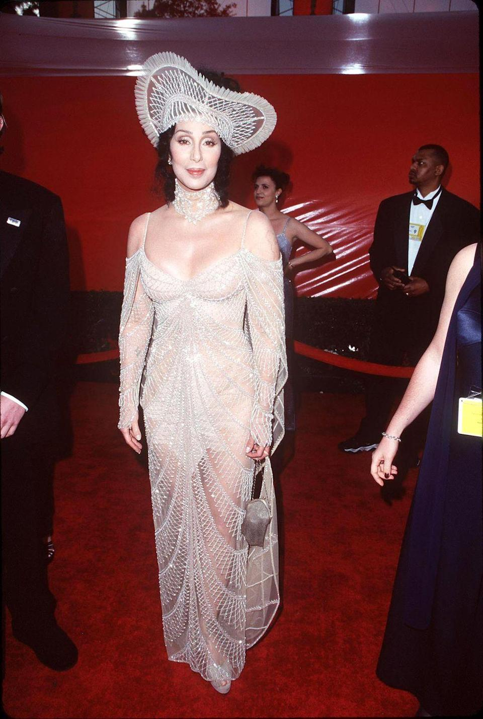 <p>In a sparkling nude gown and matching headpiece at the Oscars. </p>