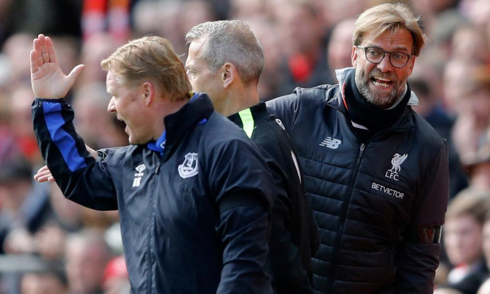 Everton manager Ronald Koeman and Jürgen Klopp have words on the touchline during the game.