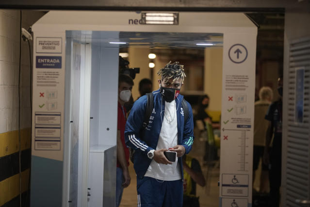Flamengo's Gabriel Barbosa passes through a body scanner as he arrives at the Maracana stadium to play a Rio de Janeiro soccer league match against Bangu in Rio de Janeiro, Brazil, Thursday, June 18, 2020. Rio de Janeiro's soccer league resumed after a three-month hiatus because of the coronavirus pandemic. The match is being played without spectators to curb the spread of COVID-19. (AP Photo/Leo Correa)
