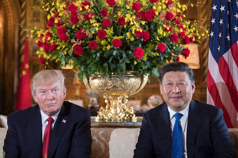 "After a meeting with with Chinese President Xi Jinping, President Donald Trump (L) says the US could solve the North Korean ""problem"" without China (AFP Photo/JIM WATSON)"