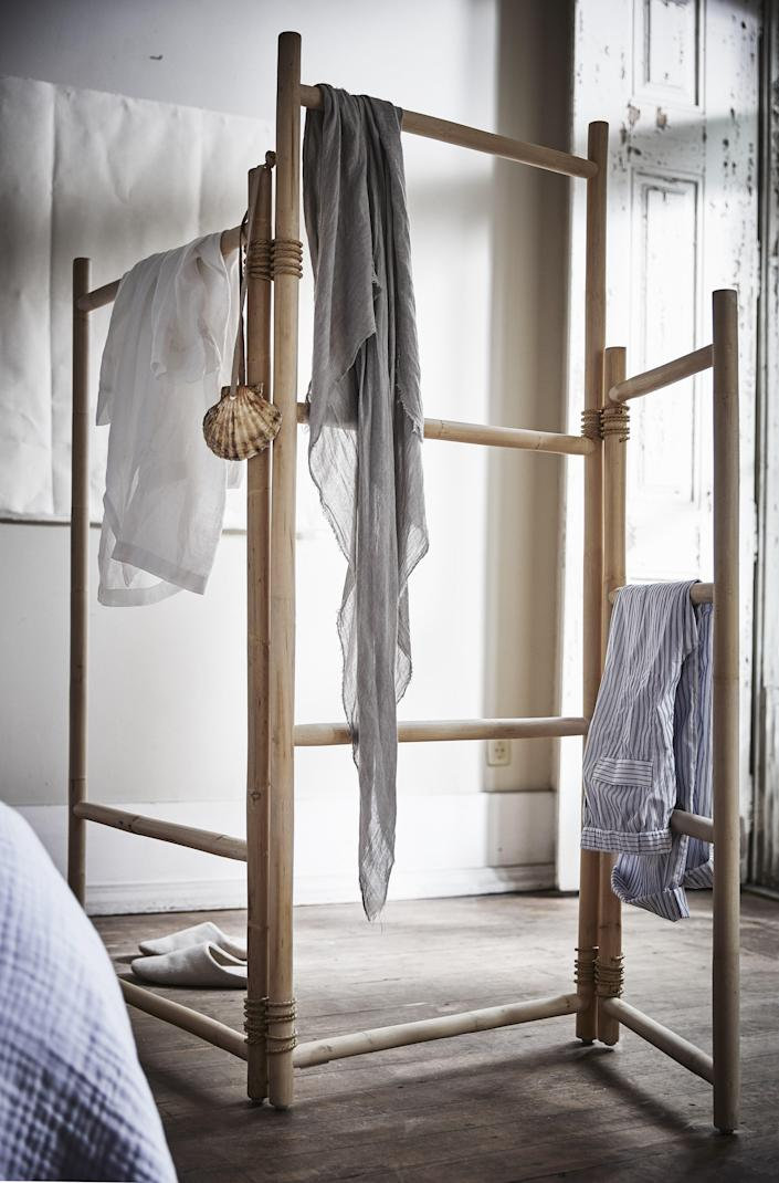 """This room divider has all others beat. Drape your fave <a rel=""""nofollow noopener"""" href=""""https://www.architecturaldigest.com/story/13-abstract-throws-that-will-instantly-make-over-a-blah-home?mbid=synd_yahoo_rss"""" target=""""_blank"""" data-ylk=""""slk:abstract throw"""" class=""""link rapid-noclick-resp"""">abstract throw</a> over the rattan bars or use it as a makeshift clothing rack—because some of us <a rel=""""nofollow noopener"""" href=""""https://www.architecturaldigest.com/story/maximalist-response-marie-kondo-minimalist-mandate?mbid=synd_yahoo_rss"""" target=""""_blank"""" data-ylk=""""slk:refuse to Marie Kondo our apartments"""" class=""""link rapid-noclick-resp"""">refuse to Marie Kondo our apartments</a>. <a rel=""""nofollow noopener"""" href=""""https://www.ikea.com"""" target=""""_blank"""" data-ylk=""""slk:SHOP NOW"""" class=""""link rapid-noclick-resp"""">SHOP NOW</a>: TÄNKVÄRD Room divider by IKEA, $89.99, ikea.com."""