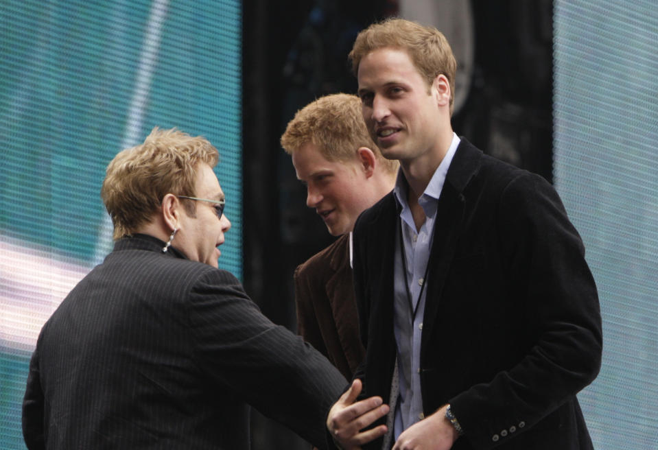 """CONCERT FOR DIANA -- Pictured: (l-r) Singer Elton John speaks with Prince Harry and Prince William on stage during the """"Concert for Diana"""" held at Wembley Stadium, Wembley, London, England on July 1, 2007  (Photo by Edmond Terakopian/NBCU Photo Bank/NBCUniversal via Getty Images via Getty Images)"""