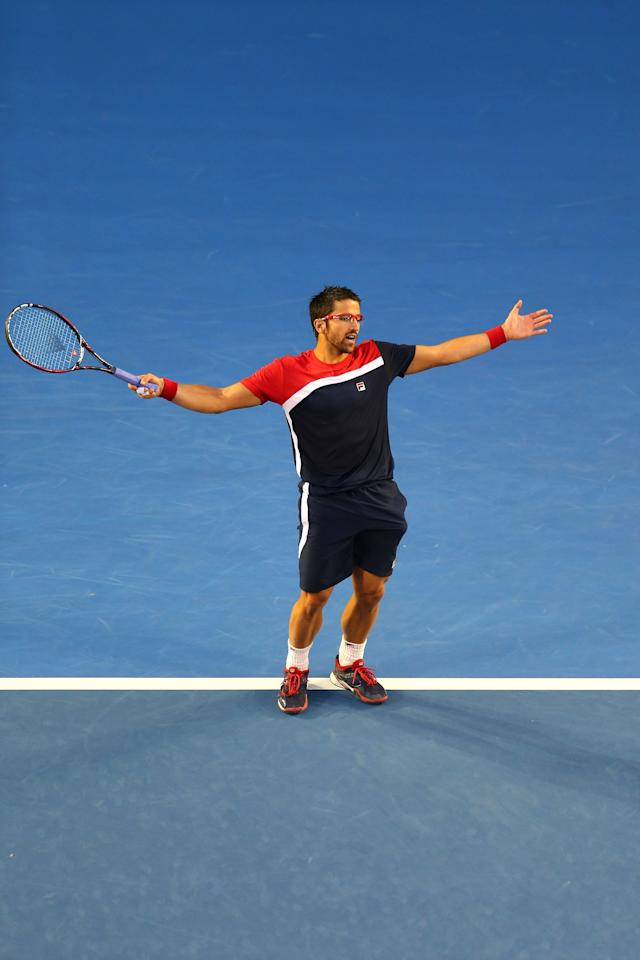 MELBOURNE, AUSTRALIA - JANUARY 14:  Janko Tipsarevic of Serbia reacts in his first round match against Lleyton Hewitt of Australia during day one of the 2013 Australian Open at Melbourne Park on January 14, 2013 in Melbourne, Australia.  (Photo by Scott Barbour/Getty Images)