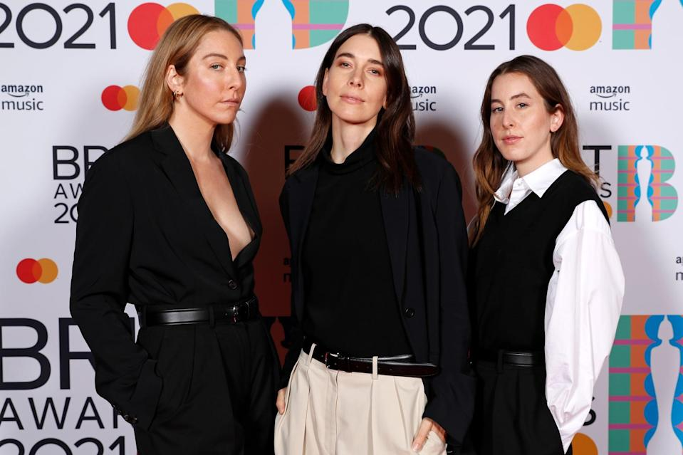 LONDON, ENGLAND - MAY 11: (L-R) Este Haim, Danielle Haim,and Alana Haim of Haim pose in the media room during The BRIT Awards 2021 at The O2 Arena on May 11, 2021 in London, England. (Photo by JMEnternational/JMEnternational for BRIT Awards/Getty Images)