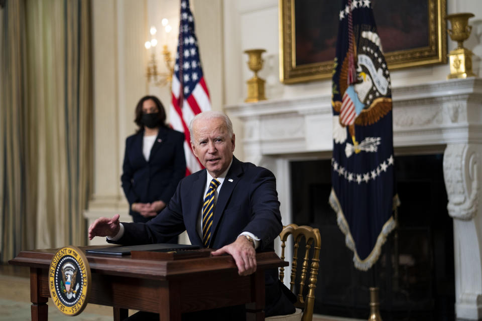 WASHINGTON, DC - FEBRUARY 24: U.S. President Joe Biden signs an Executive Order on the economy with Vice President Kamala Harris February 24, 2021 in the State Dining Room of the White House in Washington, DC. The order is intended to address a global shortage of semiconductors, or computer chips, as well as a multi-sector economic review regarding how to shore up supply chains. (Photo by Doug Mills-Pool/Getty Images)