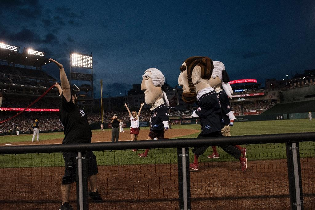 Mascots representing former US presidents race during the Congressional Baseball Game between Democrats and Republicans at Nationals Park (AFP Photo/Brendan Smialowski)