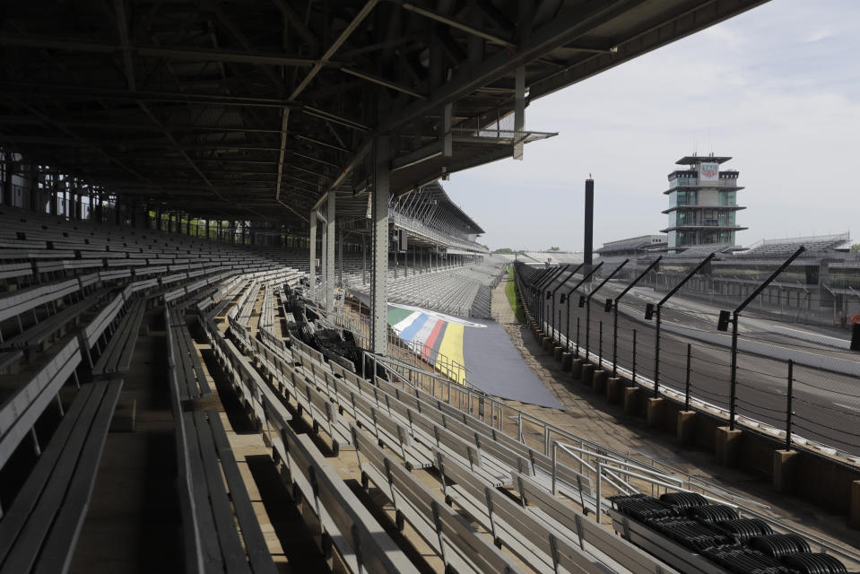 Indianapolis Motor Speedway is empty, Sunday, May 24, 2020, in Indianapolis. The Indianapolis 500 was postponed because of the coronavirus pandemic. The race will instead be held Aug. 23, three months later than its May 24 scheduled date. (AP Photo/Darron Cummings)