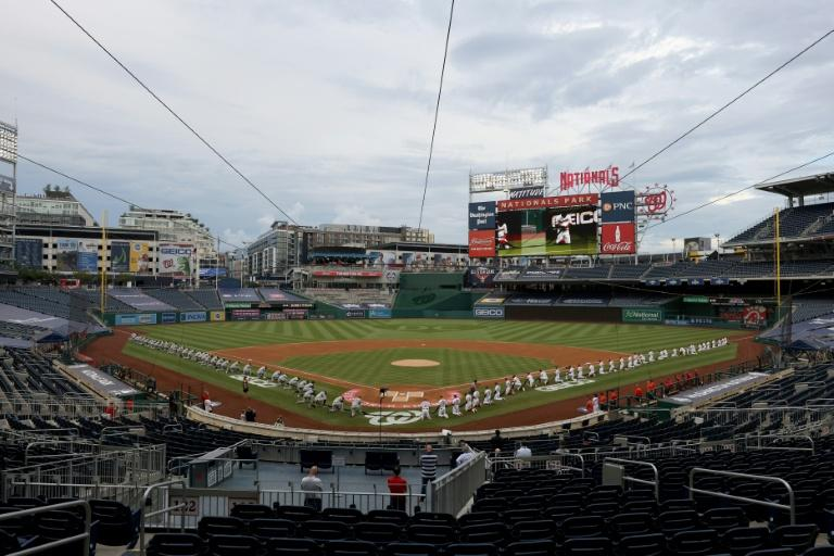 The New York Yankees and the Washington Nationals kneel in a moment of silence for Black Lives Matter at Major League Baseball's season-opening game