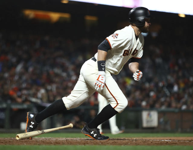 San Francisco Giants' Brandon Belt runs to first base after hitting a two-run double off Cincinnati Reds' Dylan Floro in the sixth inning of a baseball game Monday, May 14, 2018, in San Francisco. (AP Photo/Ben Margot)