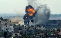 A ball of fire erupts from a building in Gaza City's Rimal residential district on May 20, during Israeli bombardment on the Hamas-controlled enclave