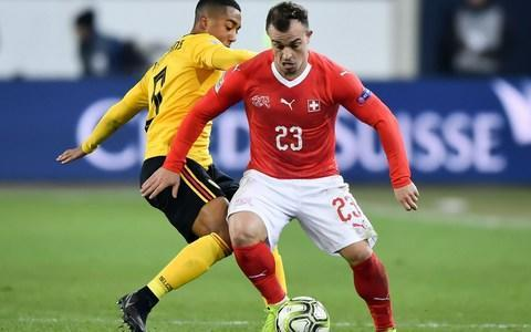 Switzerland's midfielder Xherdan Shaqiri (R) and Belgium's midfielder Youri Tielemans vie for the ball during the UEFA Nations League, league A, group 2 football match - Credit: AFP