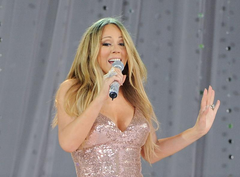"""FILE - In this May 24, 2013 file photo, singer Mariah Carey performs on ABC's """"Good Morning America"""" in Central Park in New York. Carey is in the hospital for a shoulder injury. The pop star's representative says the singer went to the hospital late Sunday, July 7, 2013, after injuring her shoulder while filming a music video. (Photo by Evan Agostini/Invision/AP, File)"""