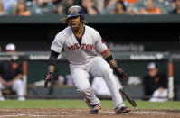 Boston Red Sox's Hanley Ramirez reacts after he was struck by a foul ball during an at-bat in the third inning of a baseball game against the Baltimore Orioles, Tuesday, June 9, 2015, in Baltimore. (AP Photo/Patrick Semansky)