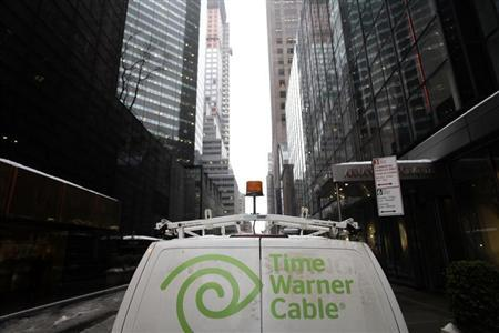 The Time Warner Cable logo is displayed on the back of a van in New York