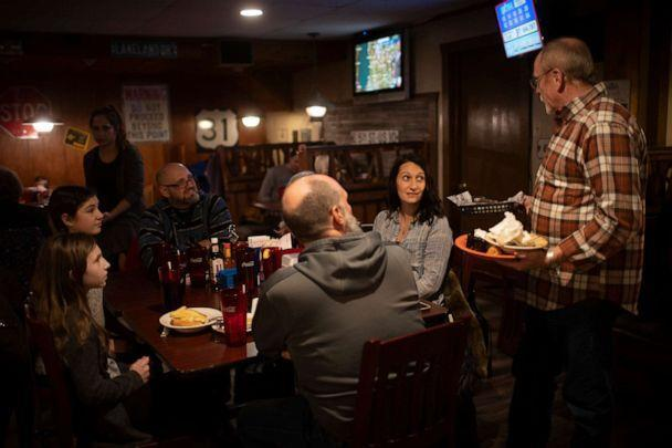 PHOTO: In this Jan. 18, 2021, file photo, Jim Cory, the owner of Jimmys Roadhouse converses with his customers at his restaurant in Newaygo, Mich. (The Washington Post via Getty Images, FILE)