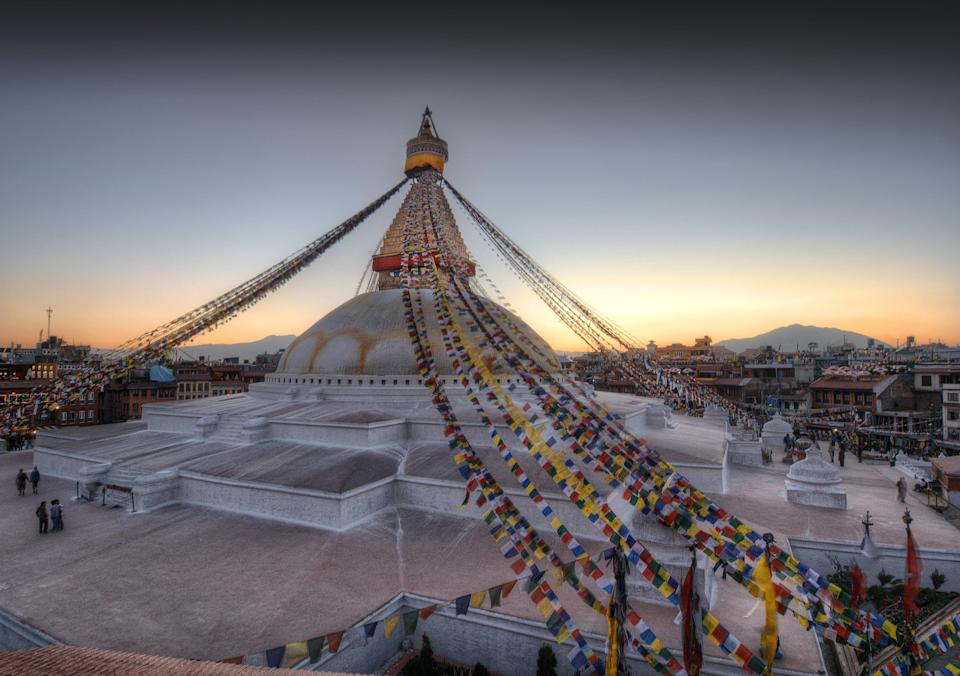 Much like Indonesia's Borobudur, the Boudhanath Stupa in Kathmandu, Nepal, is designed with levels that symbolize enlightenment. The bottom plinth represents earth, the dome represents water, the tower represents fire, and the top spire represents air. All-seeing eyes mark the tower on each side, representing Buddha's all-knowing gaze. Between the glimmering gold and white colors and the imposing spire, which draws your eyes up to the sky, the structure is truly spectacular to witness. Boudhanath is a popular pilgrimage site for Tibetan Buddhists, and a huge tourist attraction in Kathmandu.