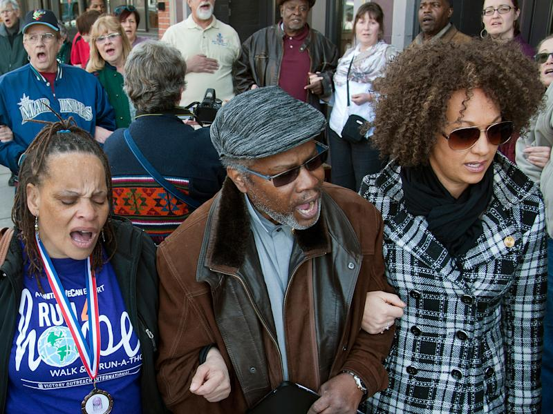 Rachel Dolezal (far right) on a march against racism with friends before she was 'outed': AP