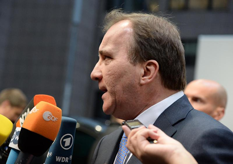 Swedish Prime Minister Stefan Loefven speaks to journalists at the EU headquarters in Brussels on December 18, 2014 (AFP Photo/Thierry Charlier)