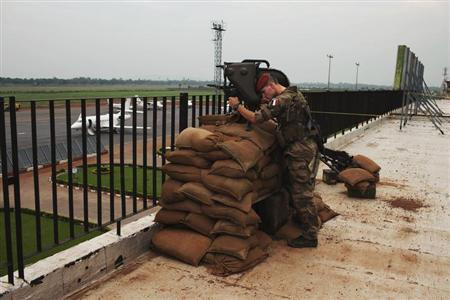 A French soldier conducts reconnaissance on the roof of the Mpoko airport in Bangui