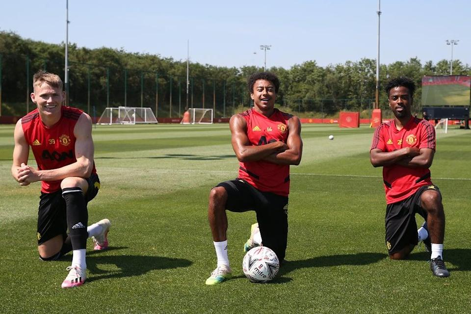 Angel Gomes, right, with Scott McTominay and Jesse Lingard in June 2020 before leaving United (Manchester United via Getty Imag)