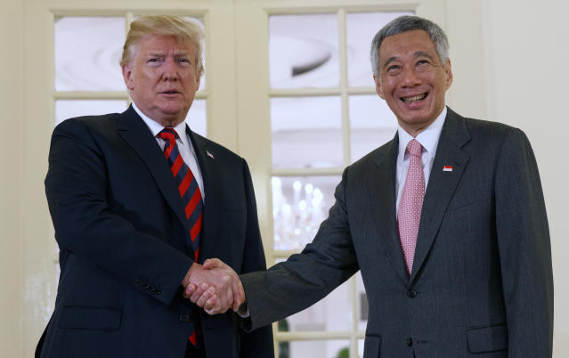 <p>Singapore's Prime Minister Lee Hsien Loong meets with U.S. President Donald Trump ahead of a summit with North Korean leader Kim Jong Un, at the Istana in Singapore on June 11, 2018. (Screenshot from video: Lee Hsien Loong/Facebook) </p>
