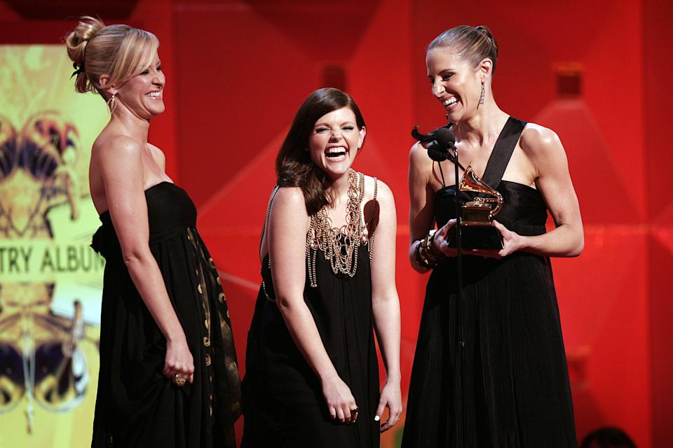 The Chicks accept their award for Best Song of the Year at the 49th Grammy Awards in Los Angeles on February 11, 2007.