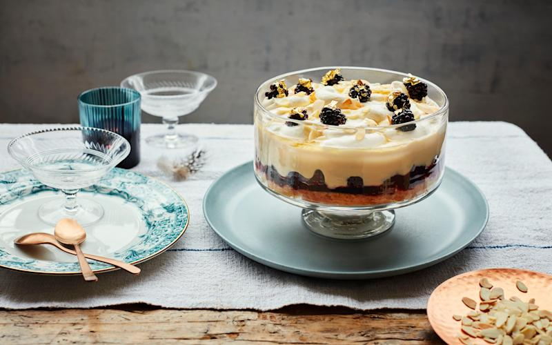 A boozy cream trifle topped with tart blackberries and honey - Laura Edwards