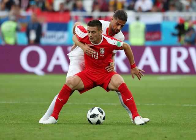 Soccer Football - World Cup - Group E - Serbia vs Switzerland - Kaliningrad Stadium, Kaliningrad, Russia - June 22, 2018 Serbia's Dusan Tadic in action with Switzerland's Ricardo Rodriguez REUTERS/Ricardo Moraes