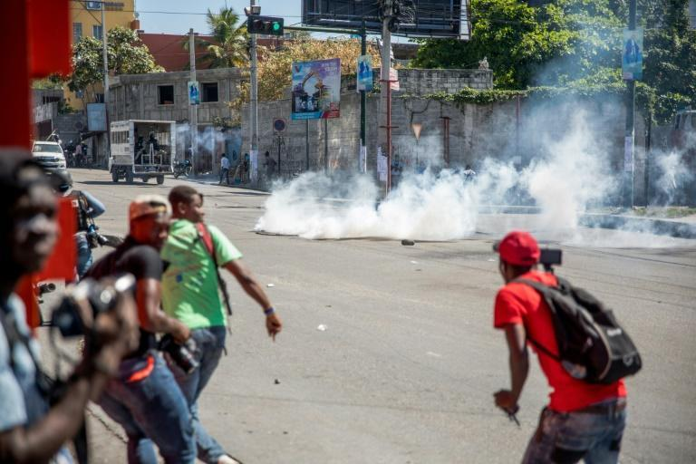 Tear gas is fired by police during a march in Port-au-Prince on February 10, 2021, to protest against the government of President Jovenel Moise