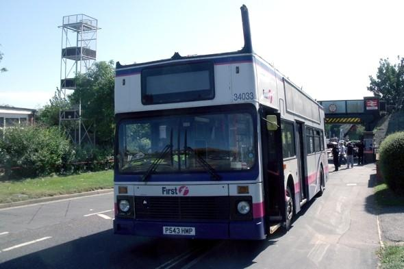 Double decker bus roof ripped off after railway bridge crash